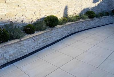 Boston Sand Porcelain Outdoor slab tiles in a garden setting of a home