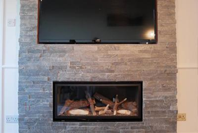 Customer Project - Penny's transformed her fireplace with our silver grey split face mosaic tiles