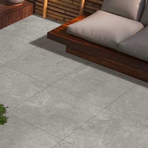 A stone effect grey porcelain patio area in a terrace style